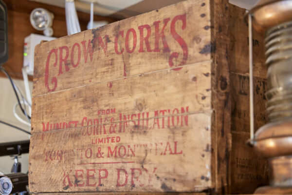 On old wooden Crown Corks box